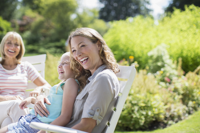 Woman smiling outside with family